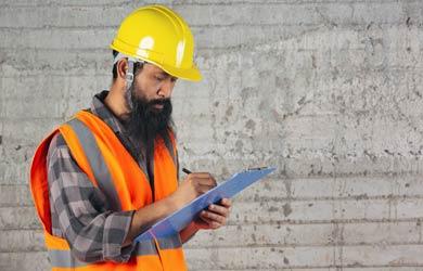construction worker with safety checklist (source: freepik.com)