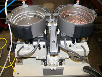 vibratory feeder- dual rivet system.JPG
