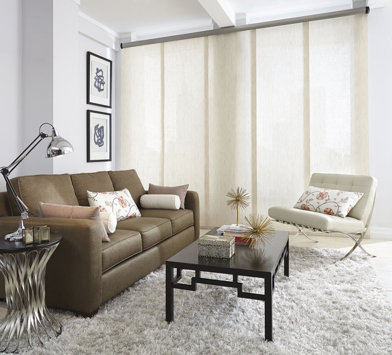 A light filtering, cream colored, Genesis® Panel track in a living room setting