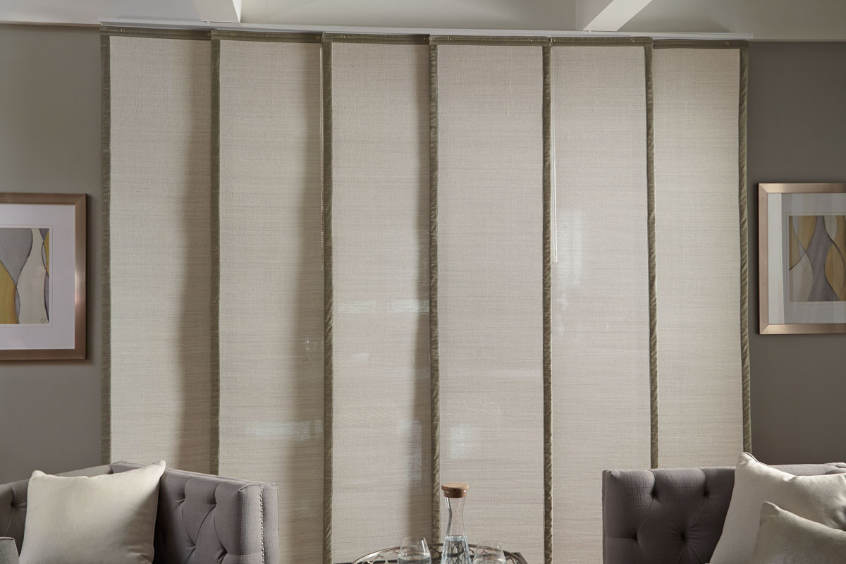 Wide light colored Manh Truc® Panel Track with green banding on each side behind gray couches
