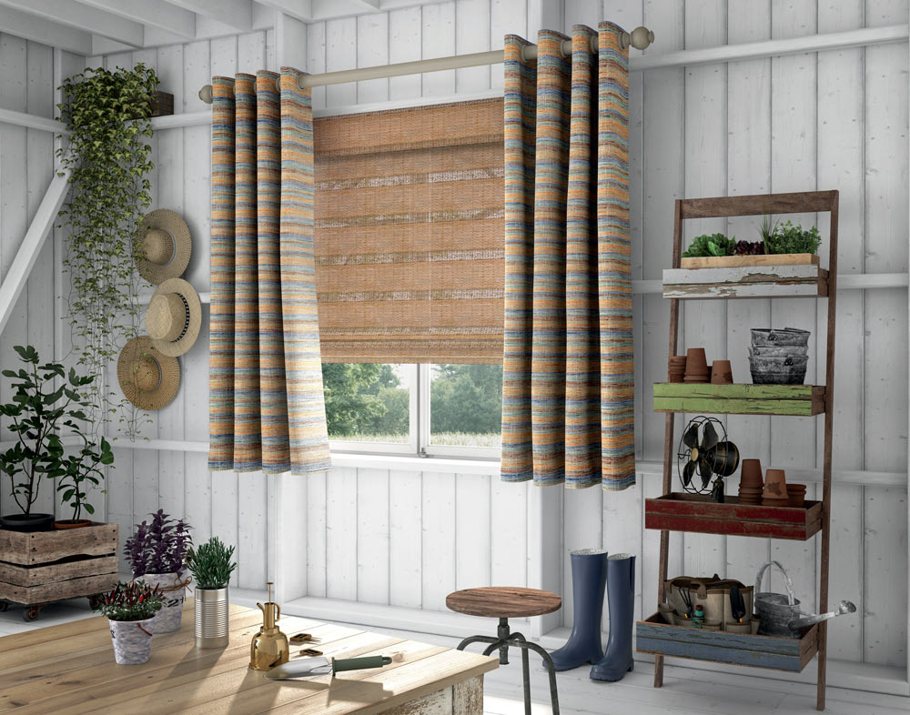Burnt orange Manh Truc® Woven Wood Shades with orange and blue pattern striped Interior Masterpieces® Draperies and wooden Custom Hardware