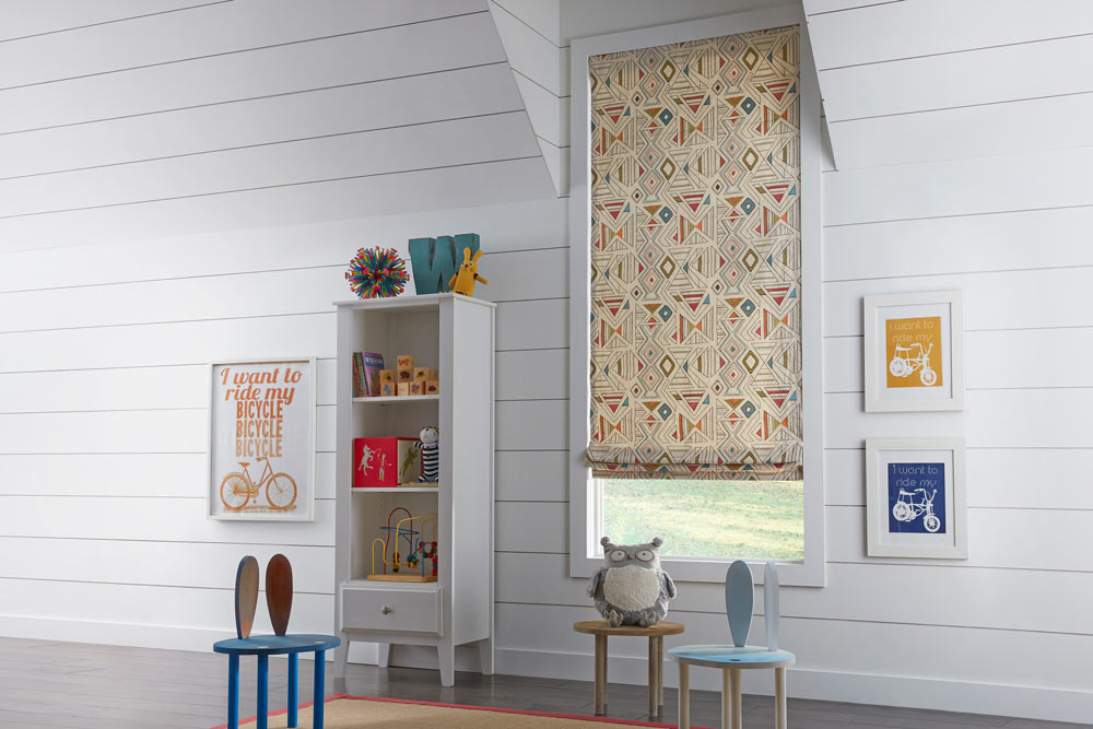 Light brown Interior Masterpieces® Fabric Shade with a geometric pattern in a child's room with little chairs and a stuffed owl sitting in front