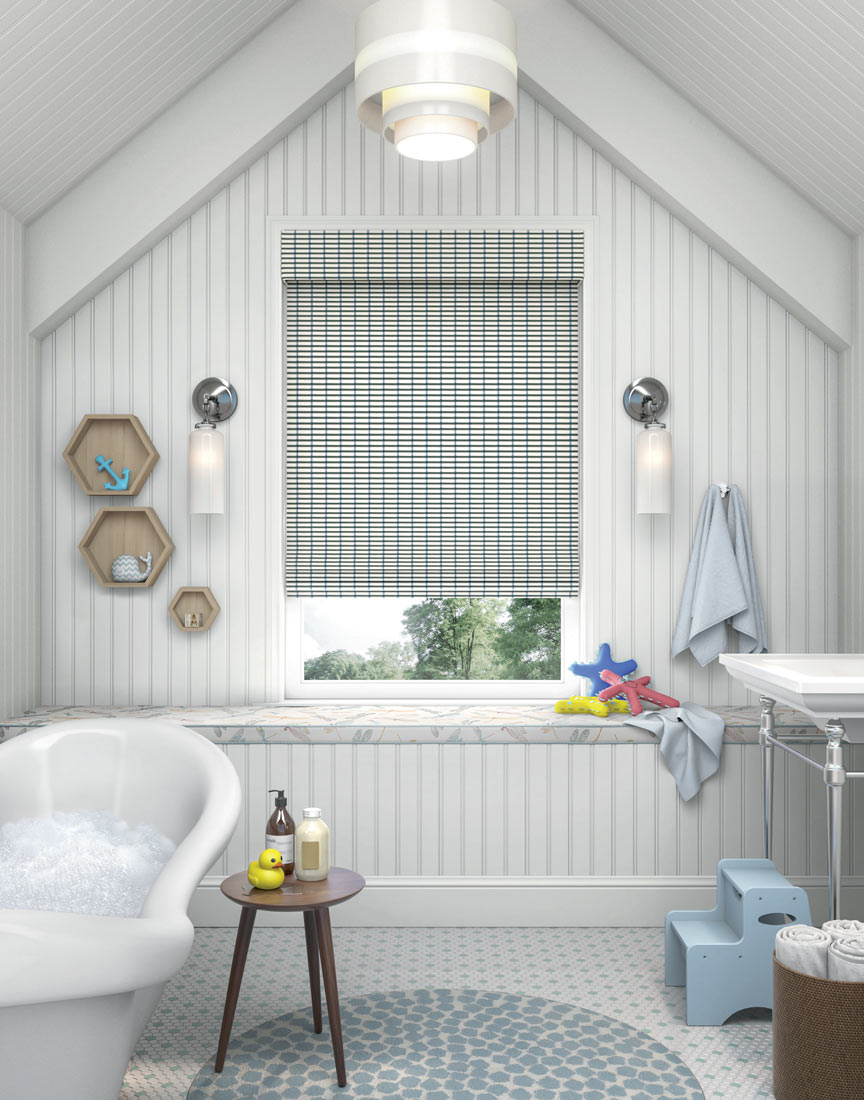 White and blue Manh Truc® Woven Wood Shade in a bathroom with a bath tub full of suds