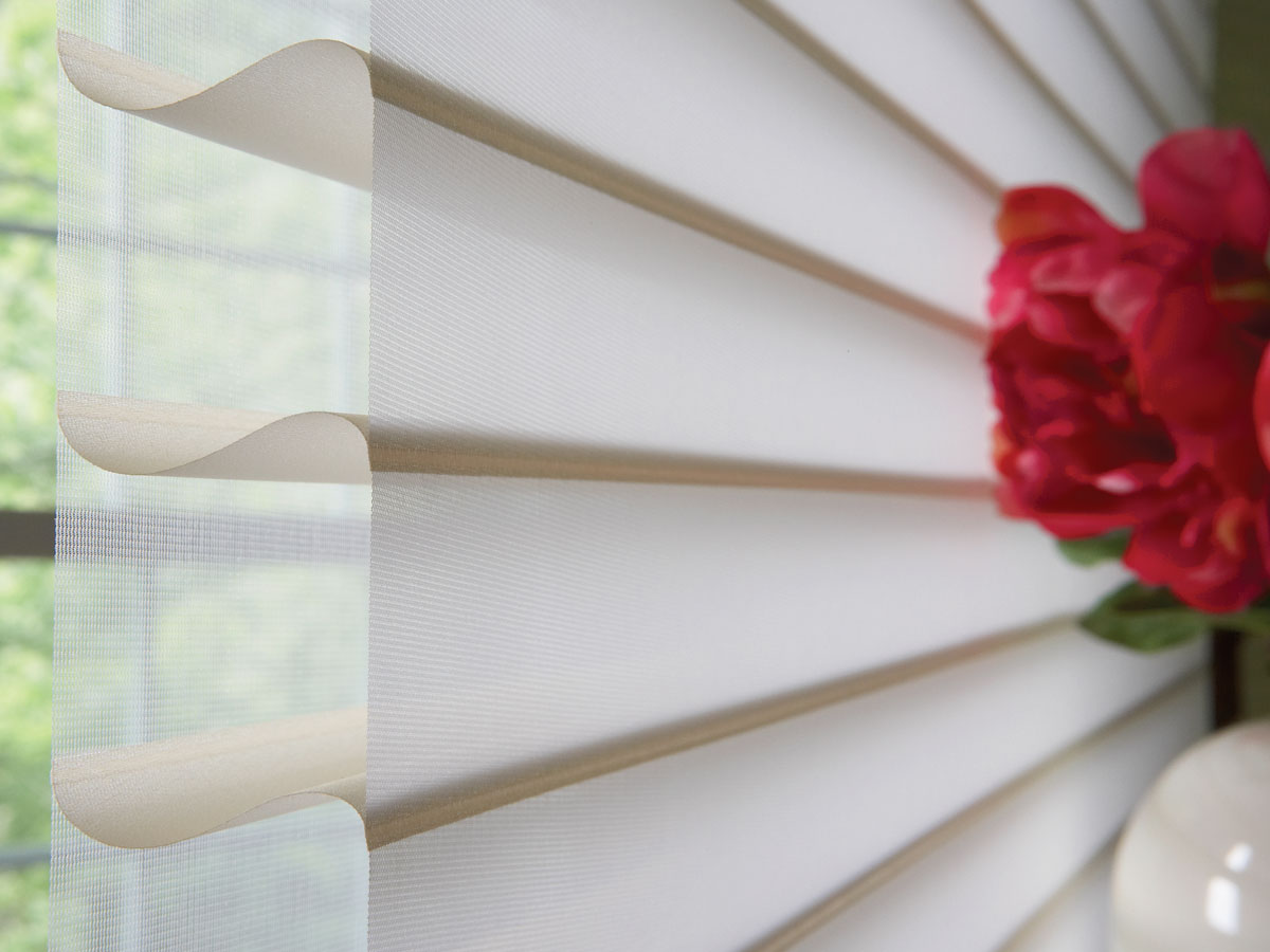 Close up view of a cream colored Tenera® Sheer Shading material