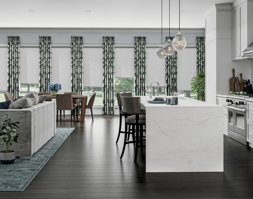 A kitchen wall of windows with white Genesis® Custom Shades and drapery panels from Interior Masterpieces®