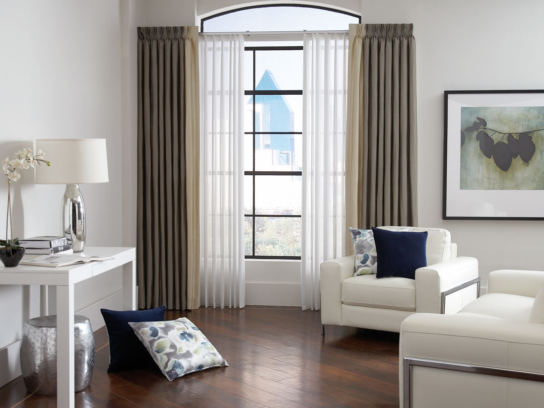 White Sheer Visions® Vertical Blinds with Interior Masterpieces® Custom Pillows and Brown and Tan Draperies