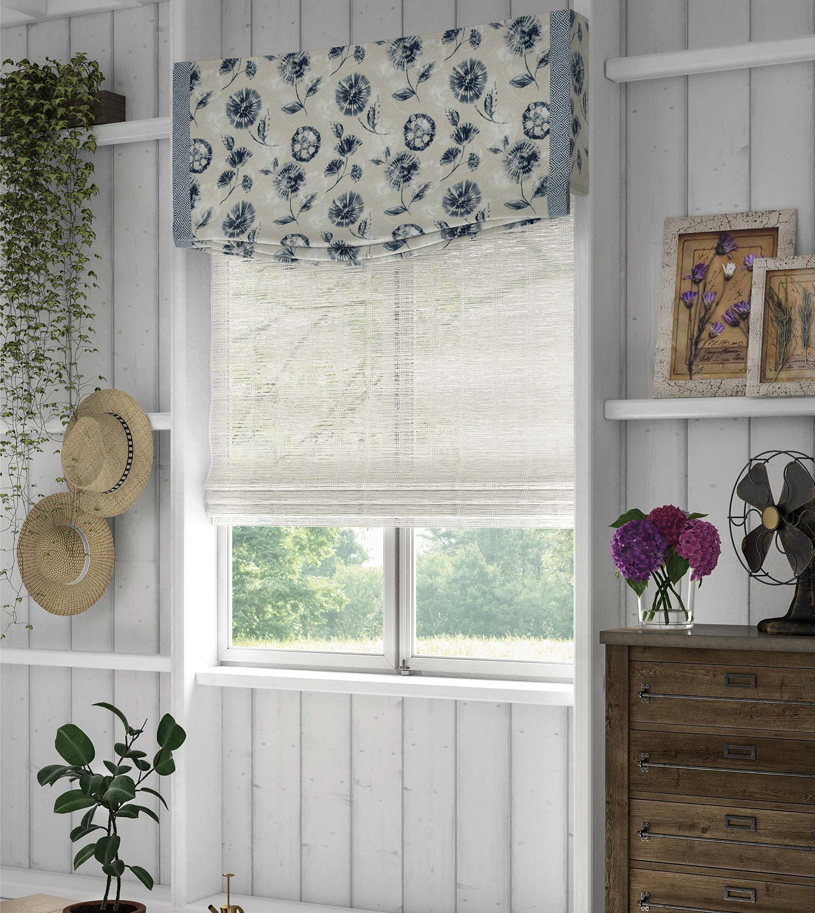 A custom fabric valance in a blue floral pattern hangs above a white woven wood fabric shade.