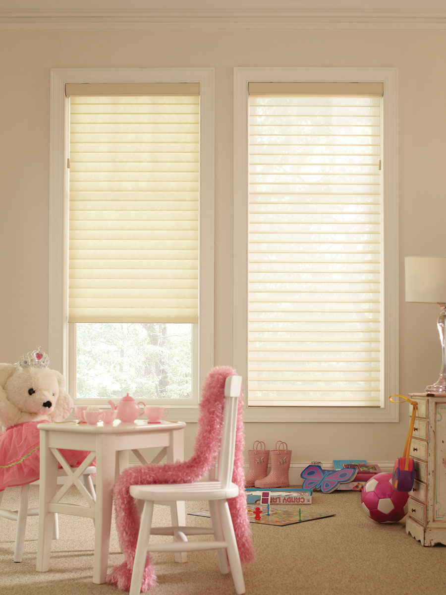 Light colored Tenera® sheer shades in a childs room with a small table and a teddy bear having a tea party
