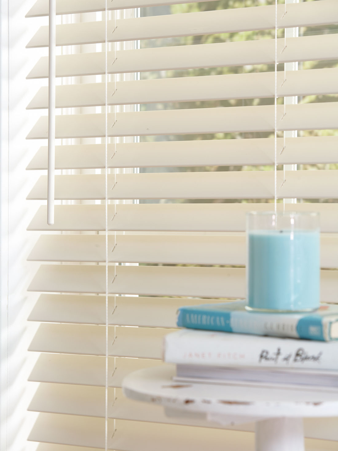 Closeup of white Fidelis® Faux Wood Blinds