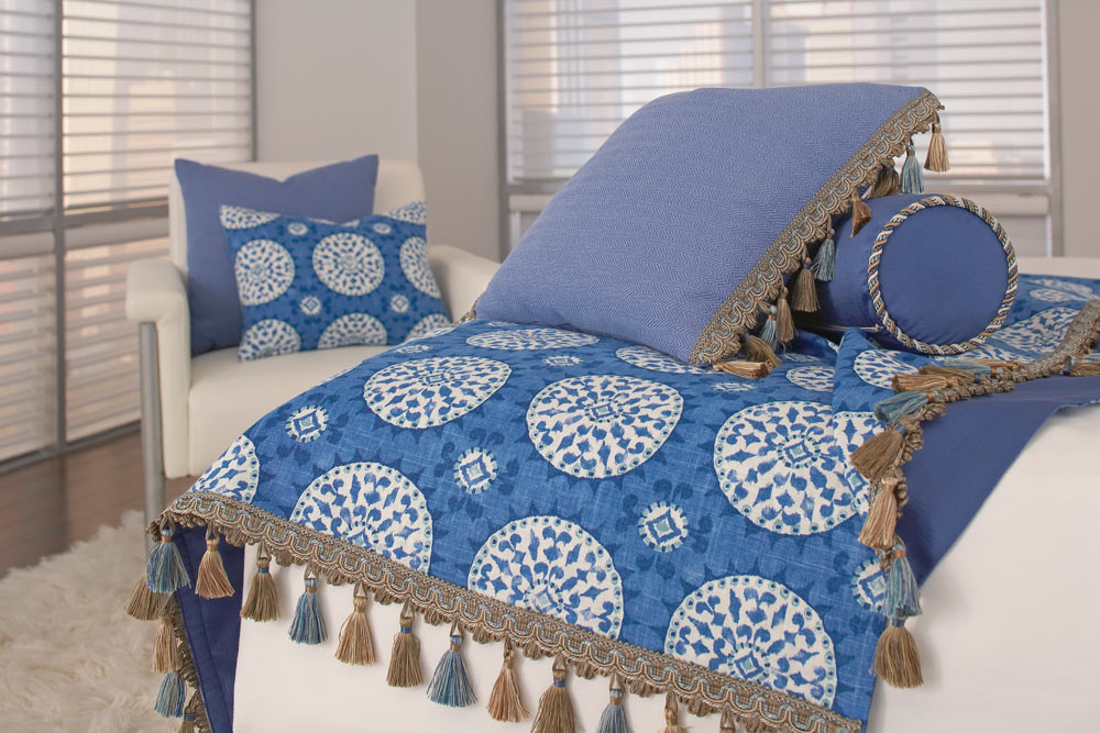Blue Interior Masterpieces® Custom Pillows and Custom Bedding in a blue blanket with white circles that has Embellishment tassels