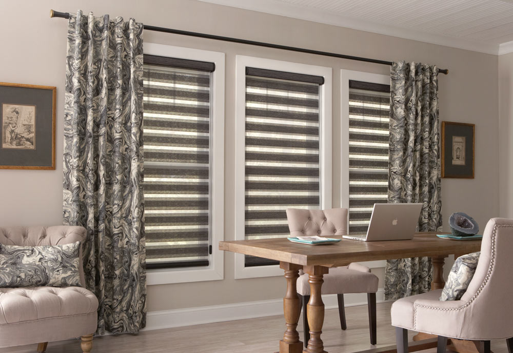 three large gray Allure® Transitional Shades in a row with inky patterned black and gray Interior Masterpieces® Draperies hanging at each end on black Custom Hardware