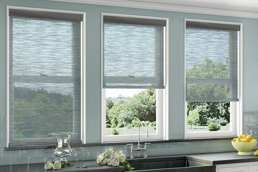 Several blue light filtering Genesis® Roller Shades in a kitchen behind the sink