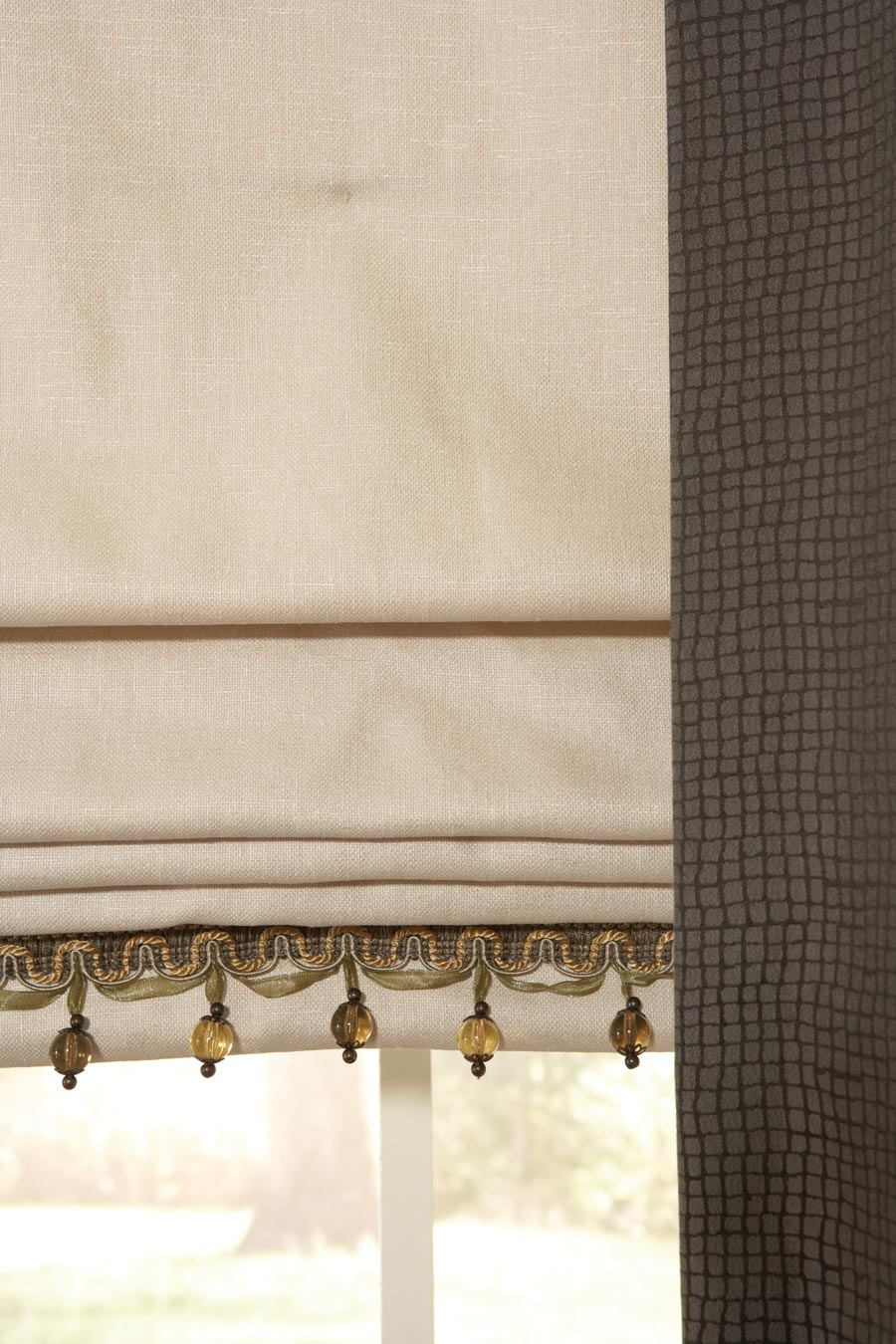 Close up view of Interior Masterpieces® Flat Roman shade with Embellishment Trim