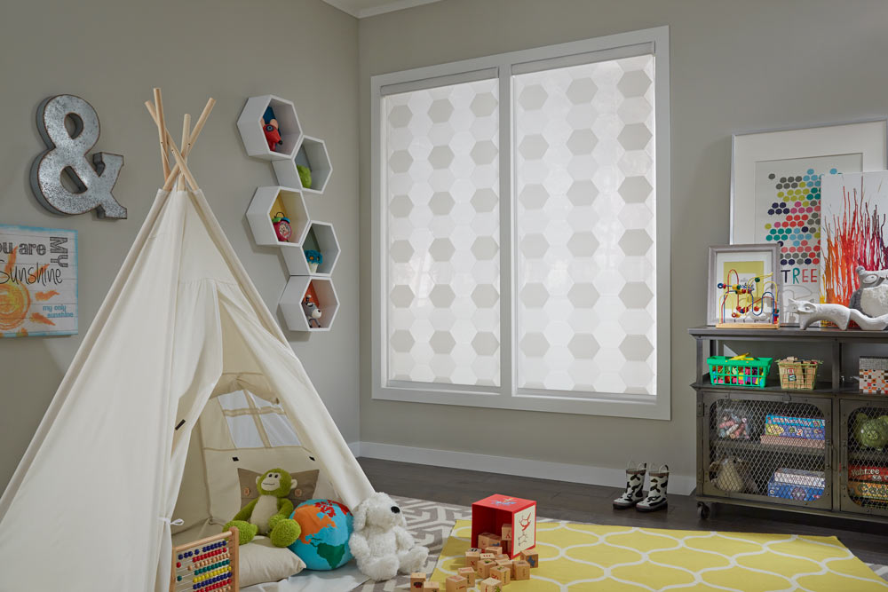 Two white Allure® Transitional Shades against gray walls in a child's room with a white tent and various playthings laying around