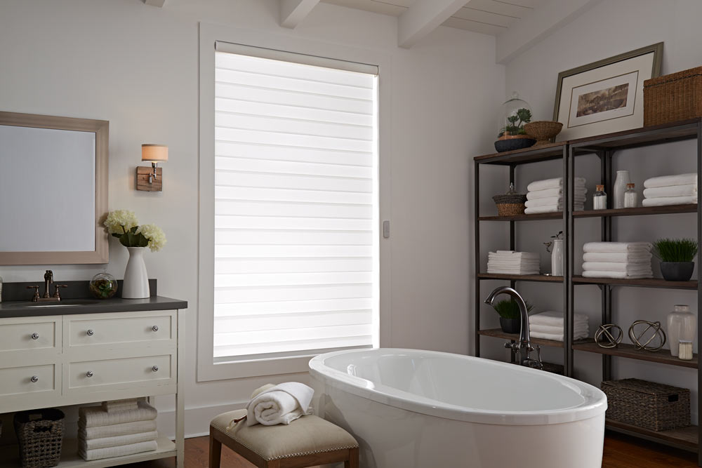 one large white Allure® Transitional Shade in a bathroom behind a stand alone tub and dark shelving