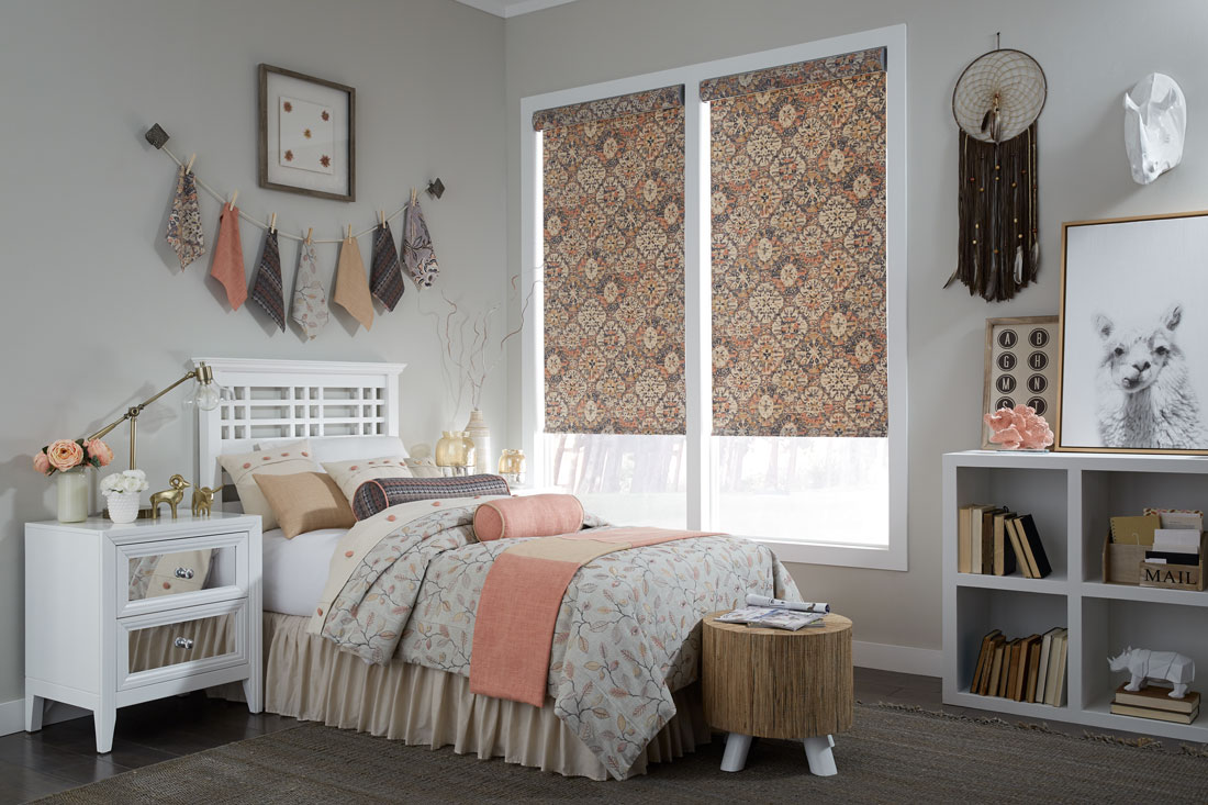 Geometric floral patterned orange and brown Interior Masterpieces® fabric shades with custom bedding on the bed in front