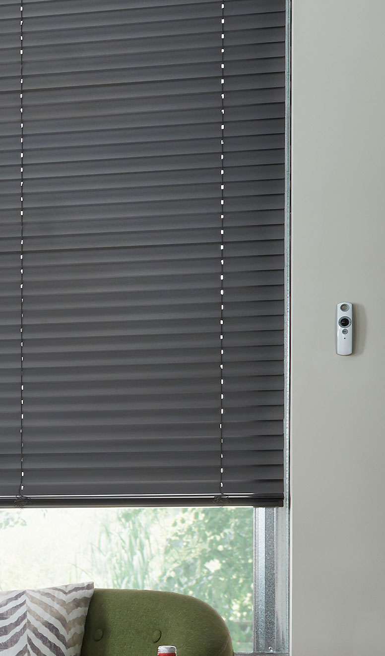 Close up of black Classic Collection® Motorized Aluminum Blinds