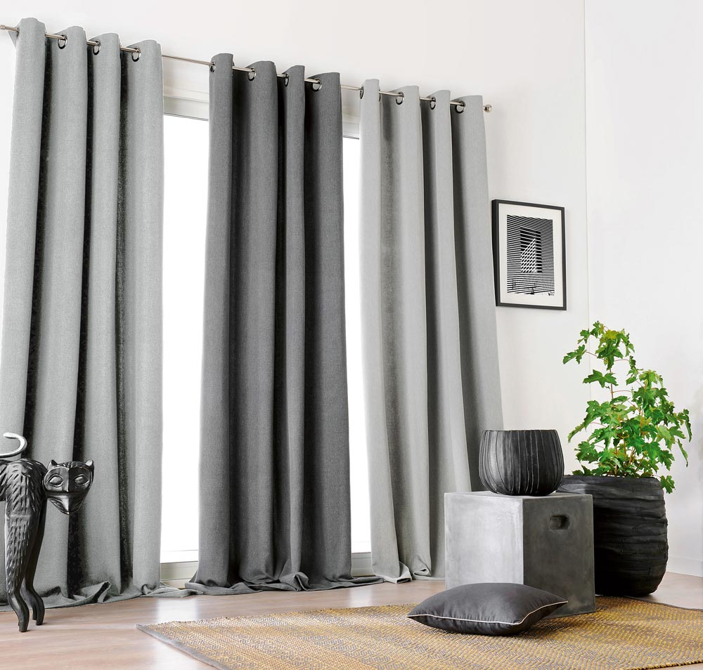 One large window with 3 Interior Masterpieces® Draperies hanging in it with light gray and dark gray