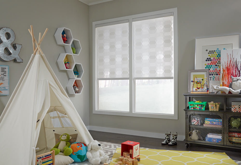 Two white honeycomb patterned Allure® Transitional Shades in a kids room with a tent filled with playthings on a yellow rug