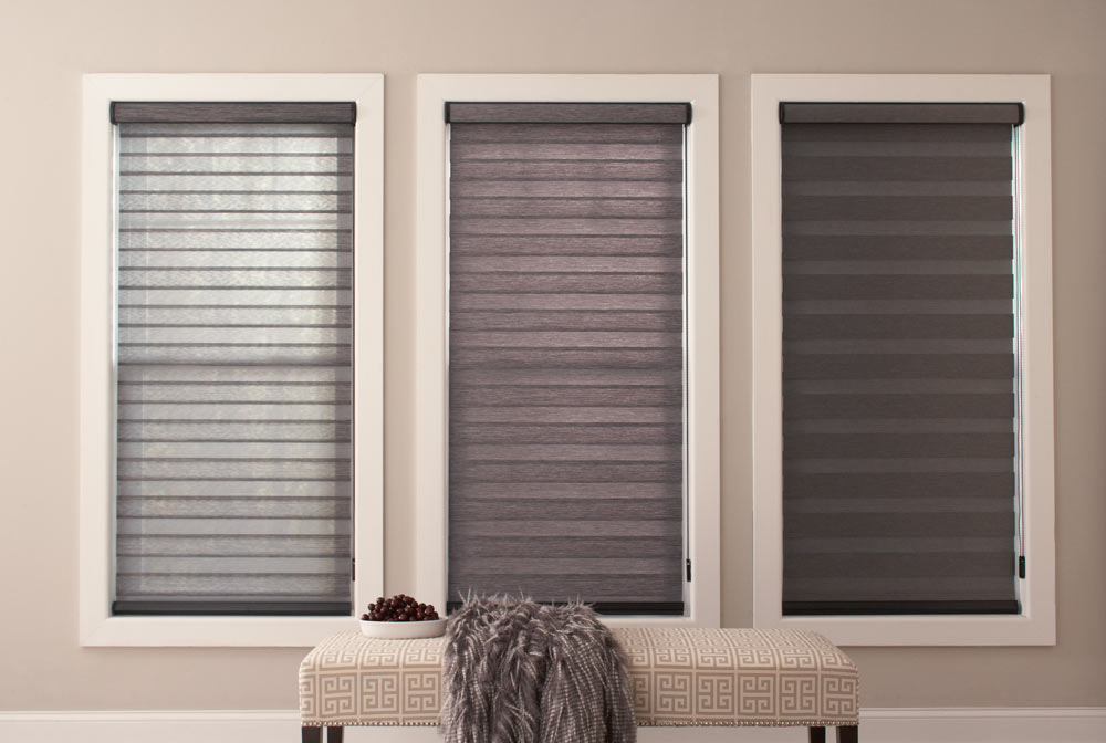 three large dark gray Allure® Transitional Shades at different opacities showing light coming through more at the left and darkening to the right