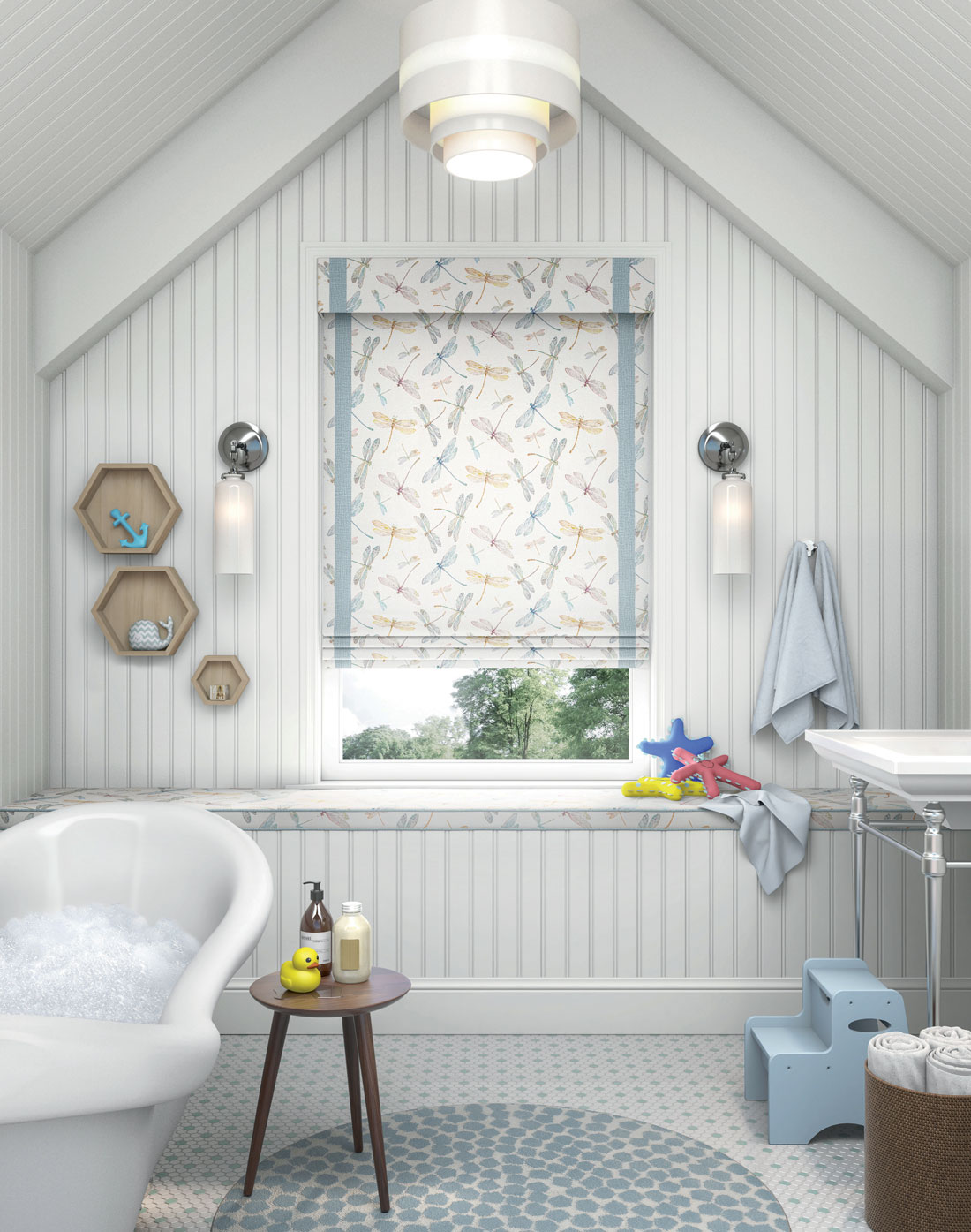 Interior Masterpieces® Fabric Shade with a playful dragonfly material and Fabric Wrapped Cornice hanging in a bathroom window with kid toys laying around and a bath tub full of suds