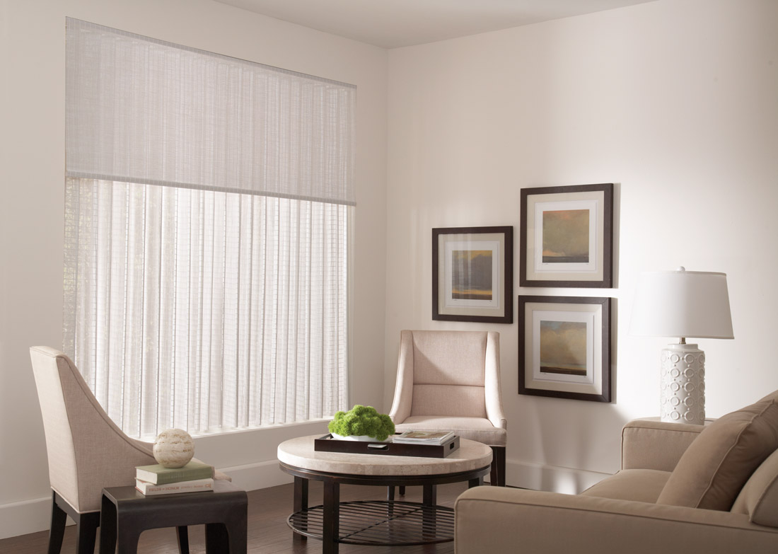 White Manh Truc® Valance and Panel Drape in a large window against cream colored walls with lightly colored chairs table and dark wood framed pictures