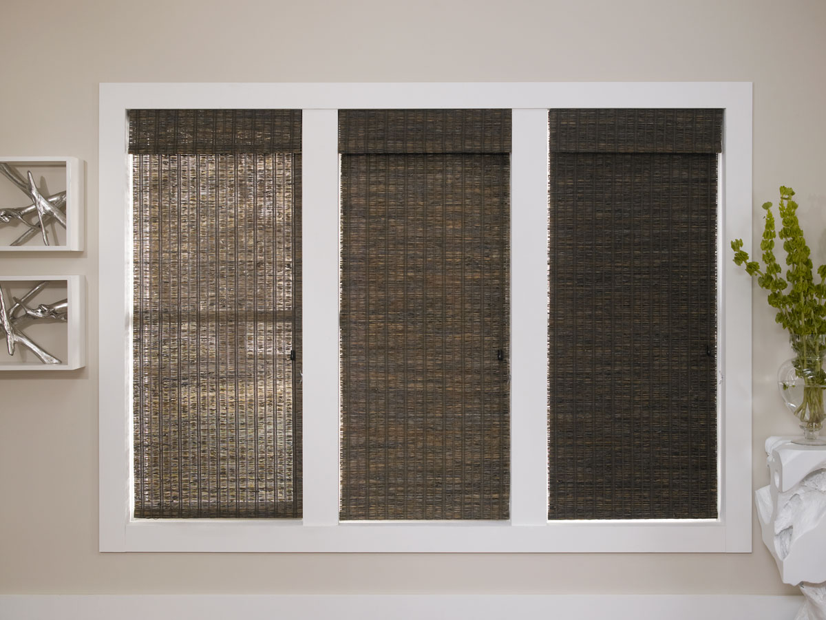 Three dark colored Manh Truc® Woven Wood Shades in Unlined, Light Filtering, and Room Darkening