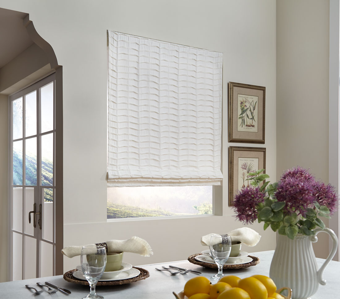 White Interior Masterpieces® fabric shade in a kitchen with purple flowers and dishwear
