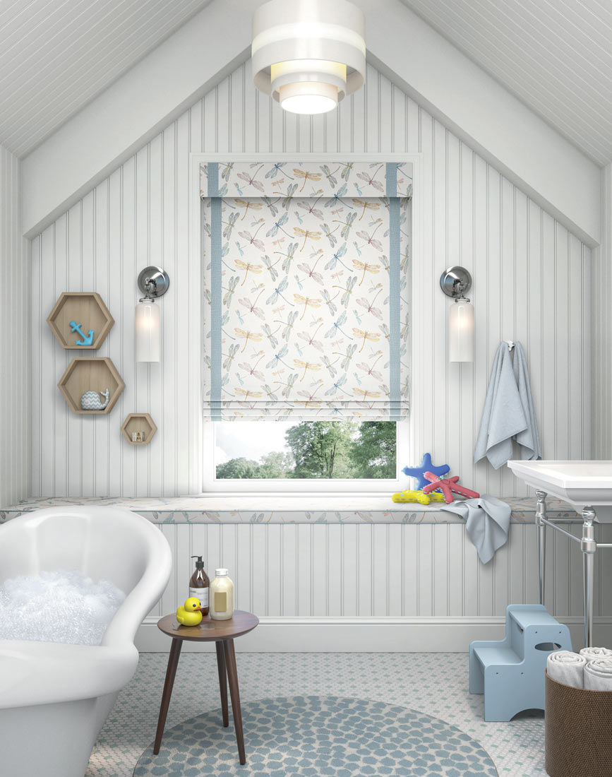 a light Interior Masterpieces® Fabric Shade with a dragonfly pattern and light blue decorative banding in a bathroom with a bath tub full of suds