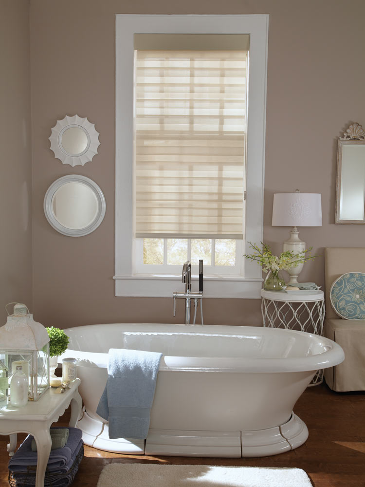 cream colored Allure® Transitional Shade in a bathroom with dark beige walls and a stand alone white tub in front