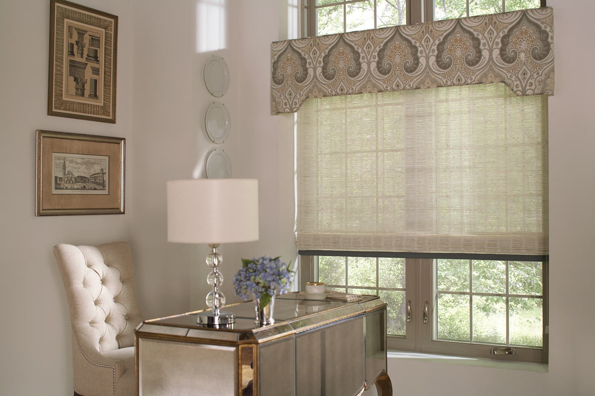 tan colored Manh Truc® Woven Wood Shades with blue Banding & light brown patterned Interior Masterpieces® Fabric Cornice