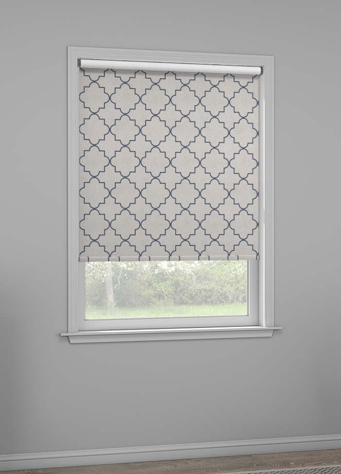 A grey shade with a navy geometrical pattern called symmetry hangs in a window.