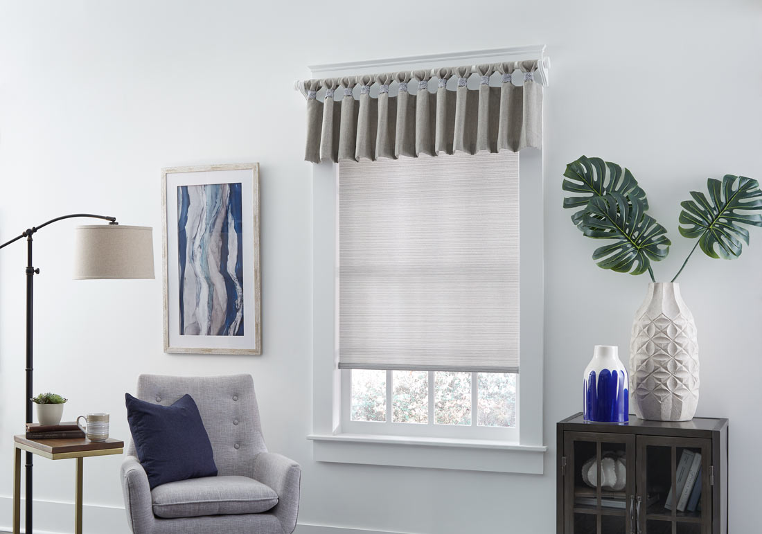 light gray Genesis® Roller Shade and a tan rippled Interior Masterpieces® Fabric Valance with Custom Hardware