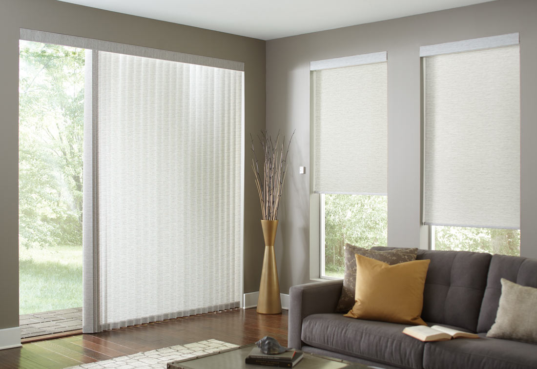 several off white Genesis® Roller Shades and matching Sheer Visions® Vertical Blinds on a large opening on the adjoining wall