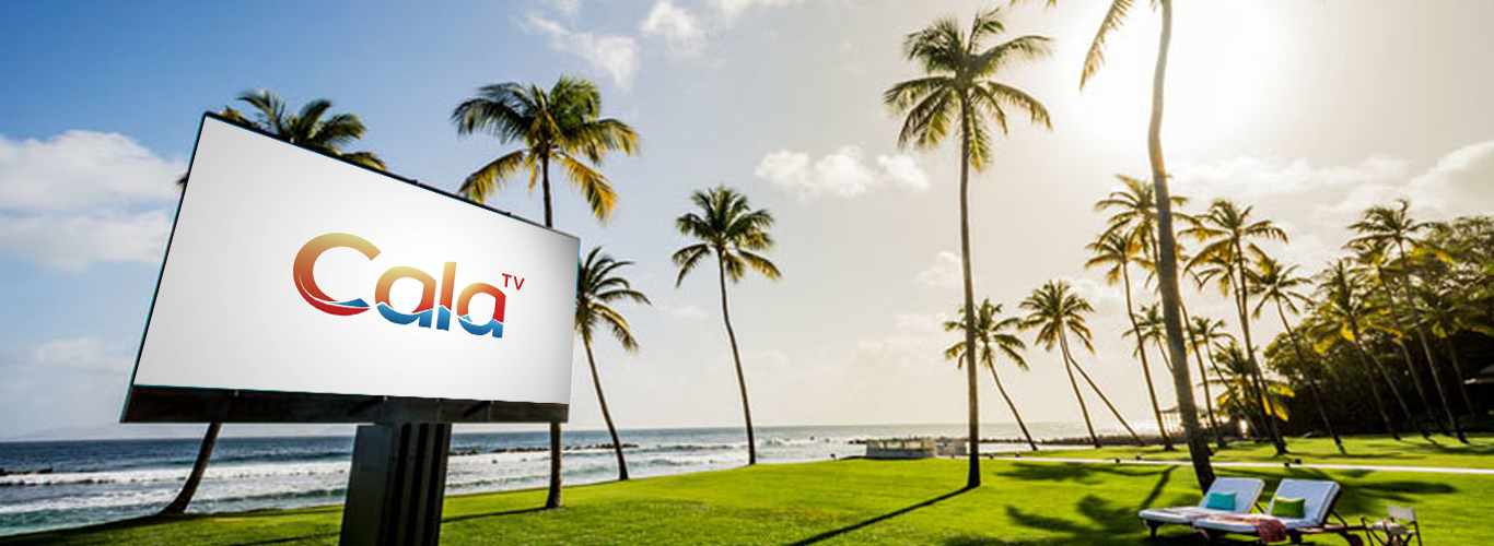 CalaTV on a billboard with ocean and beach in the background