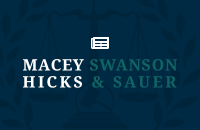 Macey Swanson Hicks & Sauer logo overlaying wreath icon with a blog icon