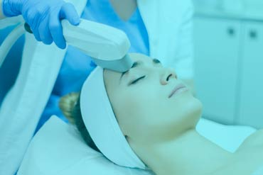 Intense Pulsed Light Therapy (IPL) performed on a woman's face as an anti-aging therapy