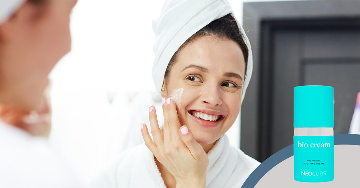 Woman applying Biocream by Neocutis as part of her nightly skin care routine