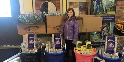 rsz_1hannah_with_donations_in_party_room_-_adj.jpg