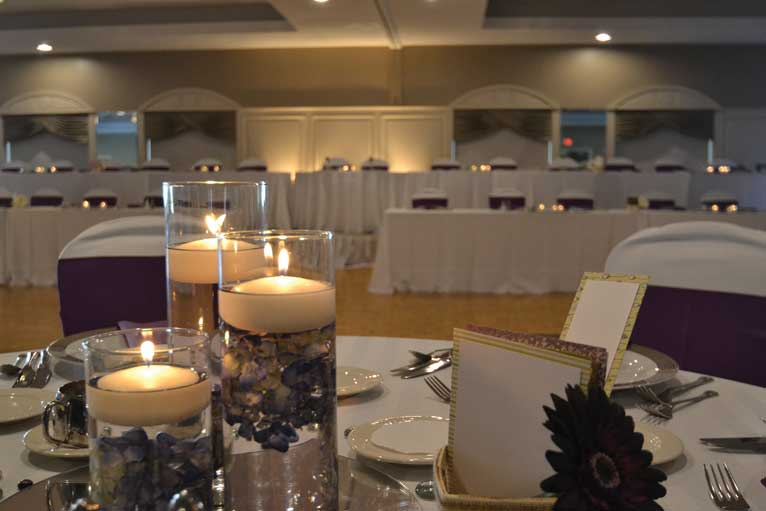 Purple and white themed wedding reception with kings table at The Ballroom at The Willows