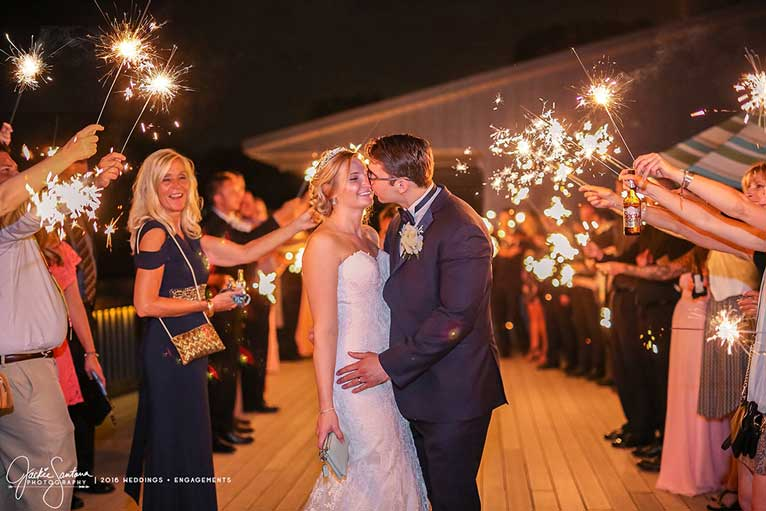 Newlyweds kiss during their sparkler exit at The Lodge at The Willows in Indianapolis