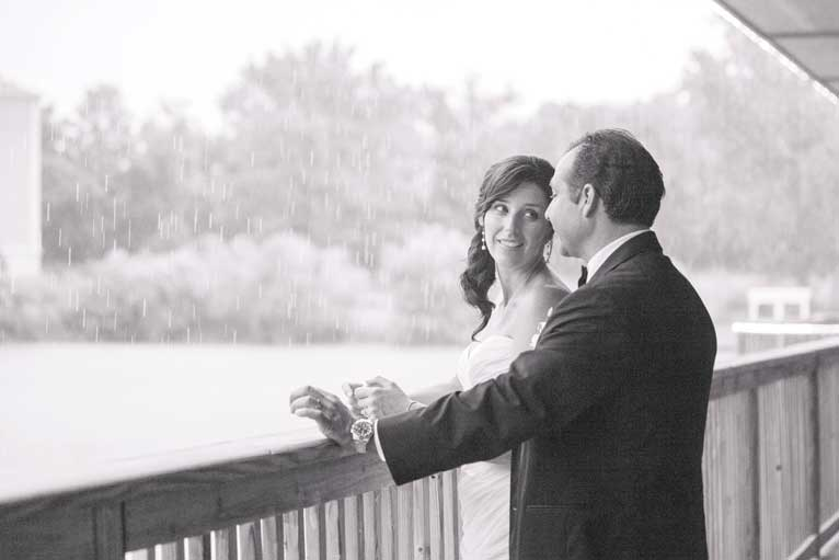 Bride and groom on the terrace of the lakefront venue The Lodge at The Willows in Indianapolis