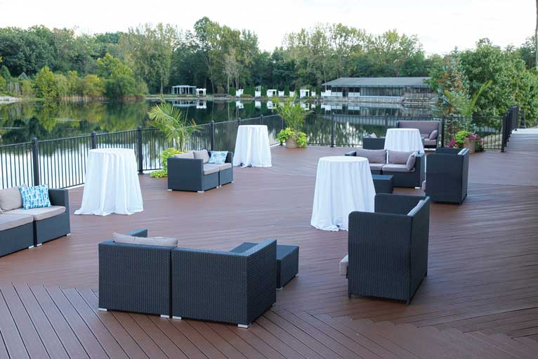 The deck at The Ballroom at The Willows featuring mix and match style seating for an outdoor reception