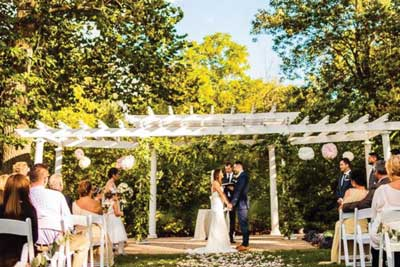 Outdoor wedding ceremony at The Lakefront Garden venue in Indianapolis