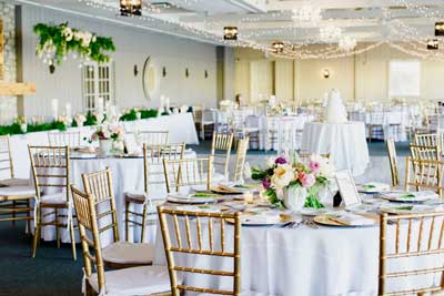 Timeless spring wedding reception held at the lakefront venue of The Lodge at The Willows in Indianapolis