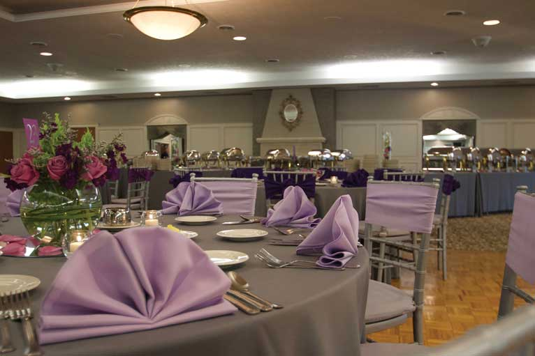 Lavender and gray themed wedding reception with buffet catering in The Ballroom at The Willows