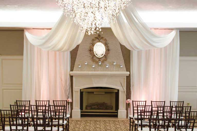 The Ballroom at The Willows hosts a white wedding ceremony in Indianapolis