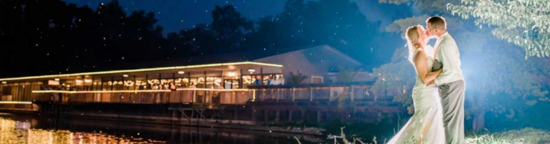 Picturesque evening wedding reception on the lake at The Lodge at The Willows