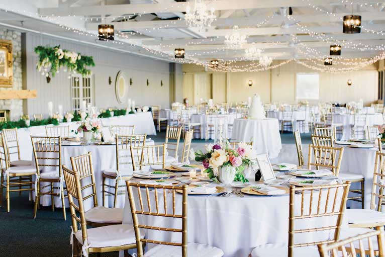 Floral themed wedding reception at The Lodge at The Willows, a lakefront Indianapolis venue