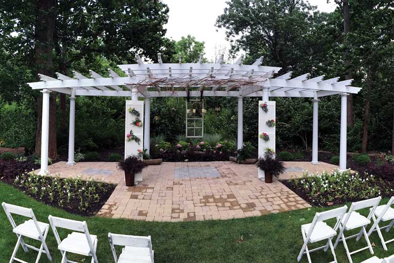 The Lakefront Gardens at The Willows in Indianapolis features a white pergola that can be decorated to match your wedding theme